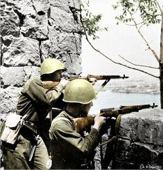 Waiting for action. Red Army soldier's armed with the semi automatic SVT-40 rifle