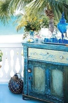 Distressed shabby chic beach decor dresser used as an outdoor bar... love the idea... great for entertaining