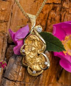 Beautiful pendant in 14Kt yellow gold with diamonds and natural Alaskan gold nuggets. Visit us online at: www.goldrushfinejewelry.com