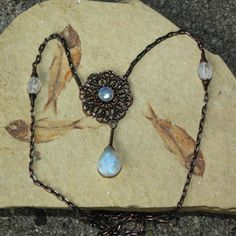 Hey, I found this really awesome Etsy listing at http://www.etsy.com/listing/70685638/moonstone-filigree-rainbow-moonstone  Beautiful-  ☆skillfully constructed. & such an unique design☆  Not to mention, well worth every penny, .. & then some... ! !