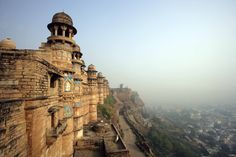 Gwalior Fort, built in around the century, overlooks Gwalior town, Madhya Pradesh and had huge influence within Indian history. World Problems, Madhya Pradesh, Air Pollution, Planets, Scenery, Mughal Empire, Hinduism, Incredible India, History