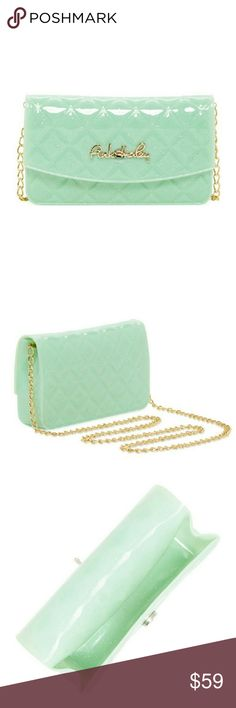 """Jade Quilted Sparkle Jelly Candy Crossbody Bag Jade Instantly add playful glamour to your look with this fun jelly crossbody. This quilted, allover glitter bag features a magnetic snap closure to secure your phone, keys, and wallet. Details: - Detachable chain drop-in shoulder strap - Front magnetic snap closure - Quilted construction with allover glitter detail - Approx. 4""""H x 7.25"""" W x 1.75"""" D - Approx. 23"""" strap drop - Materials:Rubber Pink Haley Bags Shoulder Bags"""