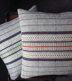 Spring green & Burnt orange wool cushions: handwoven and handmade in Wales