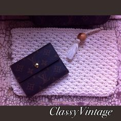 """Vintage off white clutch. This is a white woven clutch. Vintage - made in Japan.  Cloth interior that has a small pink mark on it. It has one side pocket that has a tag """"made in Japan"""". Tassel with wooden bead on zipper. 11 inches long and 7 inches high . Vintage Bags Clutches & Wristlets"""