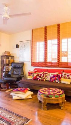 Ethnic decor. Chakki made into a pouf with a suzani covered cushion