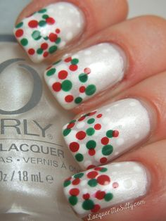 Cute & Easy Free hand, Christmas Nail Art Pearl white nails with French Manicure style tips of red & green layered dots. Layering is done by applying multiple layers of clear coat with just a few of the dots done on each layer to give the dots dimension. A word of caution- multiple layers of any clear coat will easily peel off natural nails so this design (as it's shown) is best suited for a processed nail i.e. acrylic, gel, overlay, wrap etc.