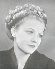 1930s fashion: vintage hairstyles with sort-of victory rolls and barrel rolls. source: http://www.hairarchives.com/private/1930snew.htm