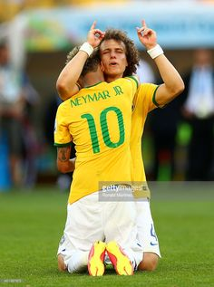 David Luiz and Neymar of Brazil celebrate after defeating Chile in a penalty shootout during the 2014 FIFA World Cup Brazil round of 16 match between Brazil and Chile at Estadio Mineirao on June 28, 2014 in Belo Horizonte, Brazil.