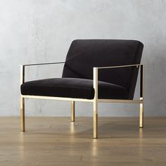 Shop cue chair with brass legs.   Designed by Mermelada Estudio, luxe lounger leans ultra modern in shiny brass and moody dark grey.  Sleek, square base sits low-ish to the ground with an extra-deep seat and wide back perfectly angled for comfort.