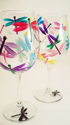 Multicolor dragonfly hand painted wine glasses set of by RaeSmith Wine Glass Crafts, Wine Craft, Wine Bottle Crafts, Hand Painted Wine Glasses, Wine Bottle Glasses, Glass Paint, Bottle Art, Bottle Painting, Dragon Flies