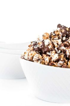 Dark chocolate and natural peanut butter are melted then drizzled over freshly popped popcorn to create this fun and easy snack or dessert recipe!