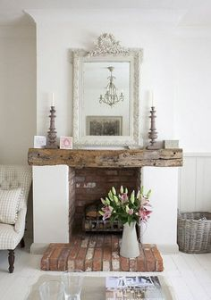 Farmhouse shabby chic living room with distressed brick, distressed wood mantle, antique white ornate mirror. Love the living room ideas from this style! Wood Mantle, Fireplace Mantle, Farmhouse Fireplace, Fireplace Ideas, Shabby Chic Fireplace, Fireplace Design, Cottage Fireplace, Simple Fireplace, Mantel Ideas