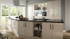 A shaker style Sheraton kitchen in a neutral gloss stone finish. Also available in white.  See http://www.sheratonkitchens.co.uk/kitchens?category%5B%5D=shaker&finish%5B%5D=Gloss