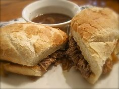 Crock Pot – French Dip Sandwiches French Dip Sandwiches(Makes 6) 3 lb boneless rump roast 1 can french onion soup 2 cups beef broth 1 large red onion sliced 3 Tbsp olive oil (for browning/sauteing) 6 hoagie buns