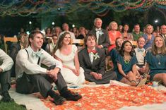slideshow/movies of the bride and groom growing up on a sheet and projector :D