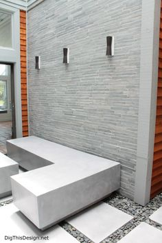 """Design by Patricia Davis Brown. """"Modern Industrial Zen"""" atrium style with Flos sconce lights, Island Stone cladding and custom concrete furniture and pavers by Coulter Designs."""