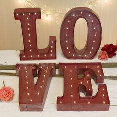 This set of red, vintage illuminated marquee letters spells the word LOVE. Each letter is illuminated by warm white LEDs and is approximately 12 inches tall .