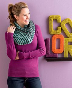 Infinity, or loop, scarves are some of my favorite accessories. Wear them long or wrap them once or twice around to create different looks. This versatile piece is worked in two contrasting colors of soft merino yarn in an undulating stripe created by increasing and decreasing