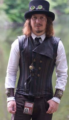 Not sure, but I think that's actually a corset vest. Male Steampunk, Steampunk Kids, Steampunk Cosplay, Steampunk Design, Steampunk Wedding, Victorian Steampunk, Steampunk Clothing, Steampunk Fashion Men, Steampunk Outfits
