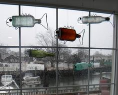 How to make DIY Hanging Bottle Fish Art from any old bottle and some wire. Great nautical decore antique bottle display. www.DIYeasycrafts.com
