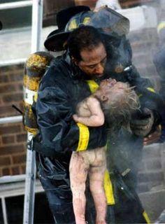 - Ron Olshwanger's 1988 Pulitzer Winning Photograph - St. Louis Firefighter -