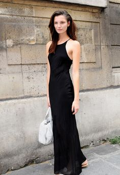 Ava dropping a floor length black number on the situation. #offduty in Paris. #AvaSmith