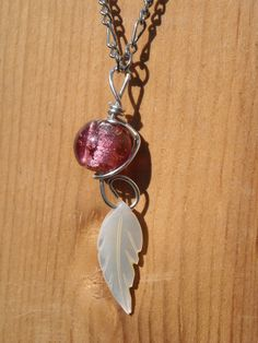Hot pink Glass bead and Shell Feather bead pendant by CraftyKikis, $14.00