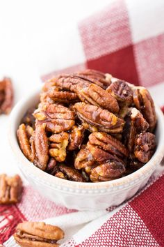 These Candied Pecans are a delicious addition to any fall dish. They're perfect on sweet potatoes, pumpkin pies, and they also make a lovely addition to salads and yogurt. Or, just eat them straight up! Pecan Recipes, Candy Recipes, Holiday Recipes, Snack Recipes, Dessert Recipes, Cooking Recipes, Snacks, Christmas Recipes, Thanksgiving Recipes
