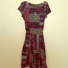 Ralph Lauren Patterned Dress Gorgeous Ralph Lauren skater style dress with suede pipeline neckline and suede belt. New with tags, size XL Ralph Lauren Dresses Midi