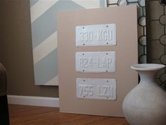 Spray painted license plates as decor.