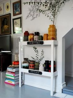 What does this photo have to do with a changing table you ask? Look closely and you'll see the IKEA Sniglar changing table upcycled into this vintage-y pottery display. Jump below to see what has become of its other half...