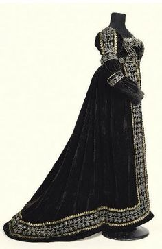 """Court Dress: ca. 1810-1820, velvet trimmed with metallic lace. Sold by Christies. Per Christies: """"This dress may have been worn by Sarah Otway-Cave, 3rd Baroness Braye. Her husband, Henry Otway, died in 1815. The colour of the dress suggests that the lady was a widow. The luxuriousness of the velvet and the expense of the silver and gold laces suggest a lady of some considerable style and substance."""""""