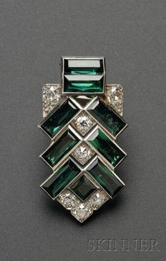 Art Deco Platinum, Tourmaline, and Diamond Clip, Cartier, bezel-set with step-cut green tourmalines and old European-cut diamond melee, lg. 1 5/8 in., no. 8719, signed Cartier.