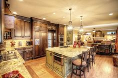Traditional Kitchen with French doors, Custom hood, Flush, High ceiling, Raised panel, Sharp Microwave Drawer, Glass panel