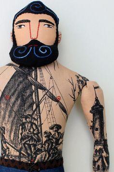 Hey, Sailor... Mimi Kirchner's blue bearded, toile tattoo man.