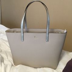 BRAND NEW Kate Spade tote purse This tote purse is brand new, gave it to my mom for Christmas but it wasn't quite her style! Nothing's wrong with it, and it's 100% authentic Kate spade! Also comes with the dust bag! kate spade Bags Totes