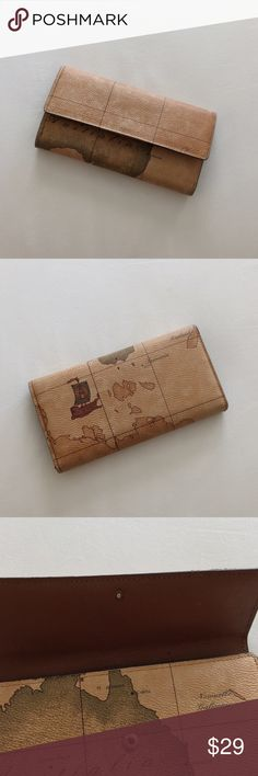 """Rare Vintage Urban Outfitters World Map Wallet Gorgeous item. Outside is in perfect condition and has a vintage world map design. As can be seen in 3rd photo, top part of clasp is missing, so the wallet closes all the way but doesn't """"click."""" A few marks on the inside, but still in perfect condition. Urban Outfitters Bags Wallets"""