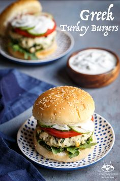 These Greek Turkey Burgers are EVERYTHING. The patties are flavored with lemon, spinach, and feta! They are perfect for the grill!