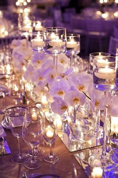 White orchid wedding flwoerswhimsical wedding centerpiece ideas with floating candles and mirror