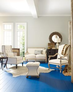 Room featuring the Nassau Settee, Lucca Arm Chair and Chandler Chair from Thomasville. Love the painted floor.