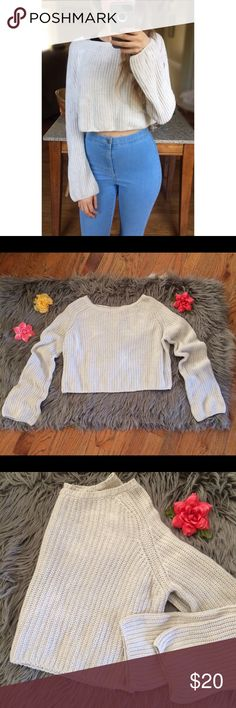 UO Cream Knit Crop Sweater 🌿 Chunky knit cream cropped sweater from Urban Outfitters! Cropped fit, slight bell sleeve. Perfect with high waisted jeans! Great condition. Best fits a size xs/small! Modeled on a size xs :)  Measurements: Total Length (top of shoulder to bottom hem)- 15 inches  Bust- 19.5 inches flat across Urban Outfitters Sweaters Crew & Scoop Necks