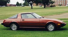 1979 Mazda RX-7.  Identical to one I had.  It even had the white lettered tires.
