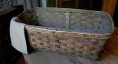 """Old Laundry Basket... My mother sold my grandmother's to a traveling """"peddler."""" I have hers and the cats sleep in it with an old blanket."""