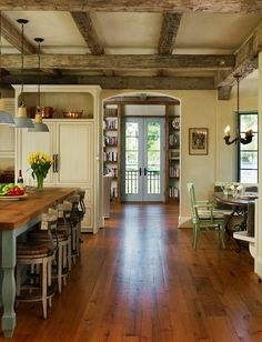 country style kitchen ideas- refrigerator behind doors. Like the greeny table legs with the benchtop.