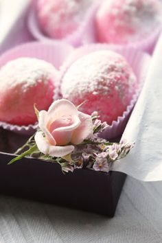 rosewater truffles - white choc ganache with 1tsp rose water added, red/pink food colouring to get pink colour.