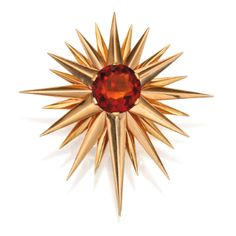 14 Karat Gold and Citrine Brooch, Verdura - Designed as a starburst centered by a round citrine, gross weight approximately 15 dwts, signed Verdura, 1941.