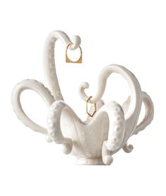 Octopus Trinket Dish: This sea creature, with its curving tentacles, makes a lively catchall for jewelry.