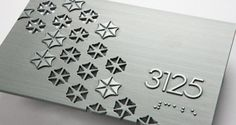 water jet cut zinc metal ADA tactile Braille Room ID sign | Dixie Graphics