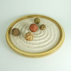 Tabletop Modern Zen Garden: Sand Play Set. Texture Spheres meant for rolling in the sand to create meditative sand patterns. Bring the beach inside and give yourself a dose of sand therapy. A unique gift idea! Many different patterns and packages to choose from.