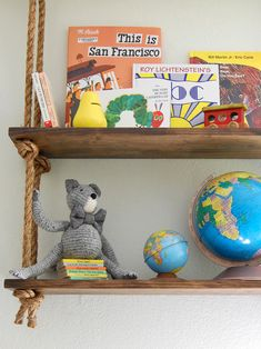 Niche Interiors: Fun nursery shelf idea! Wooden boards and jute rope tied through to create rustic wall ...